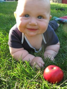 Baby smiling with apple